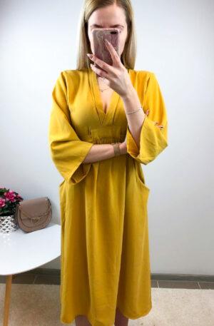 Kollane kleit taskutega