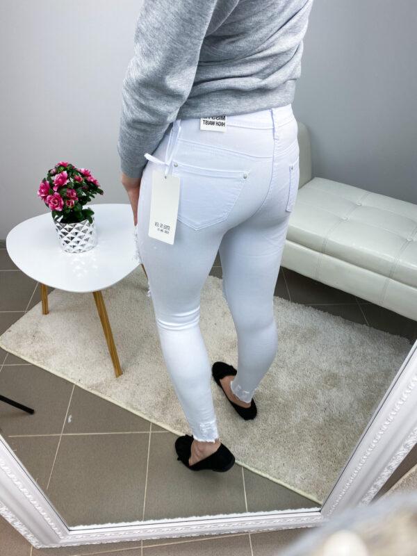Valged võrguga stretchid teksad